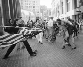 Man uses American flag to assault civil rights activist.1976.