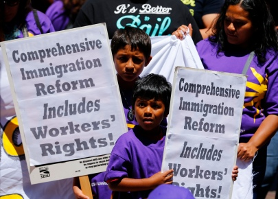 Children of immigrants look on during a protest of the United States Department of Homeland Security I-9 audits of their employment eligibility in San Diego