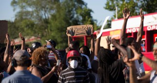 Demonstrators raise their hands while protesting the shooting death of teenager Michael Brown, in Ferguson, Missouri
