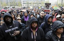 """People gather at a """"Stand Up for Trayvon Martin"""" rally in Washington"""