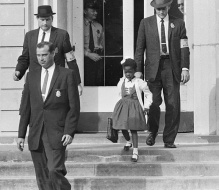 """Don't be afraid."" That's what Ruby Bridges's mother told her on November 4, 1960. Little Ruby listened carefully to the advice. Soon, four United States federal court marshals, or officers, arrived at the Bridges family home in New Orleans, La., to drive the first grader to William Frantz Public School. A screaming mob was waiting. People stood near the building shouting. Ruby held her head high. With the marshals surrounding her, the 6-year-old walked into the school and into history"
