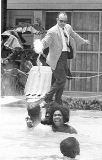 June, 1964 black children integrate the swimming pool of the Monson Motel, to force them out the owner pours acid into the water