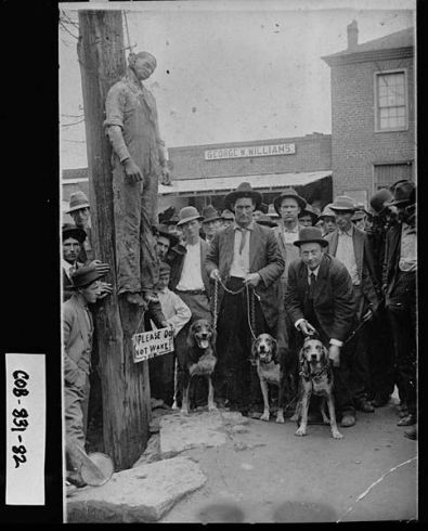 Lawrenceville,April 7,1911. Lynching of Charlie Hale,a black man,on the courthouse square at the corner of Perry and Pike Streets