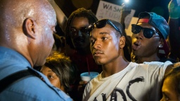 Missouri State Highway Patrol Captain Ron Johnson speaks to protesters as he walks through a peaceful demonstration as communities continue to react to the shooting of Michael Brown in Ferguson
