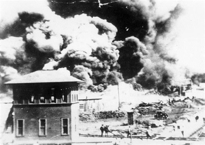 """On June 1, 1921, the Tulsa Race Riot ends. The wealthiest African-American community in the United States, the Greenwood District also known as """"Black Wall Street is completely destroyed."""