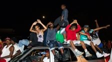 Protesters-chant-as-they-ride-on-a-car-during-a-peaceful-demonstration-as-communities-continue-to-react-to-the-shooting-of-Michael-Brown-in-Ferguson-Missouri-August-15-2014.-REUTERS_Lucas-Jackson