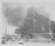 The newly built Mount Zion Baptist Church engulfed in smoke during the Tulsa Race Riot TULSA RACE RIOT OF 1921