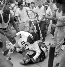 Then 18-year-old Keshia Thomas of Ann Arbor shields a man wearing a Confederate T-shirt from an angry crowd during a Ku Klux Klan rally on June 22, 1996, outside Ann Arbor's city hall