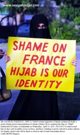 Veild woman of Jamat-e-Islami protest against the ban on Hijab in France in Islamabad